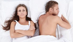 unsatisfied women laying in bed after quick sex